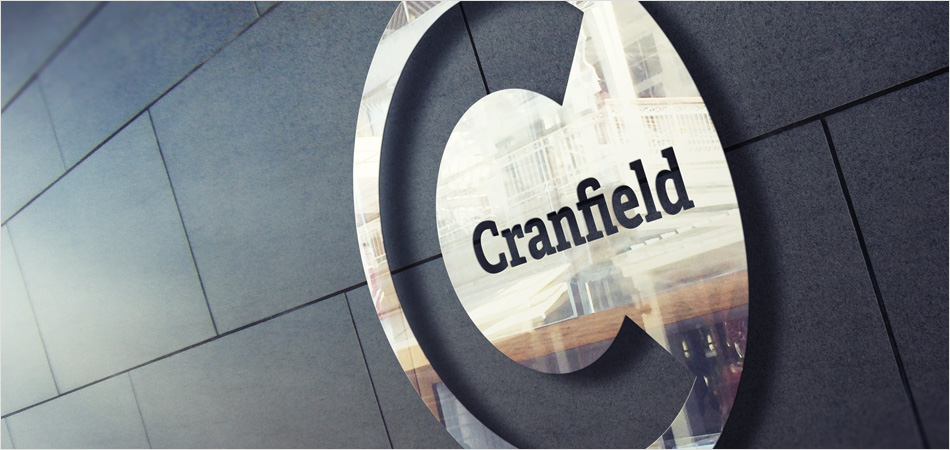 Cranfield University logo shown on chrome building signage