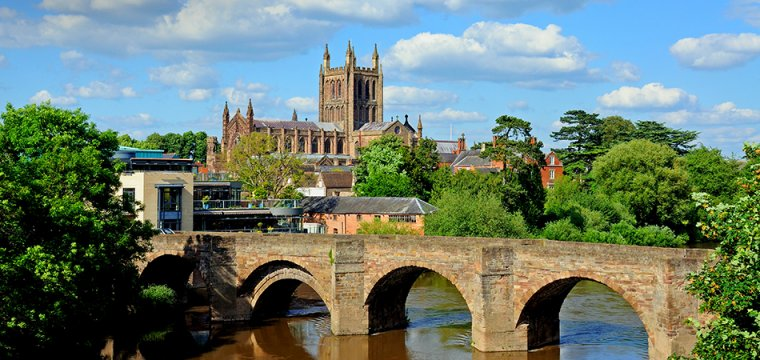 View over the city of Hereford, UK, showing the cathedral and a bridge over the river