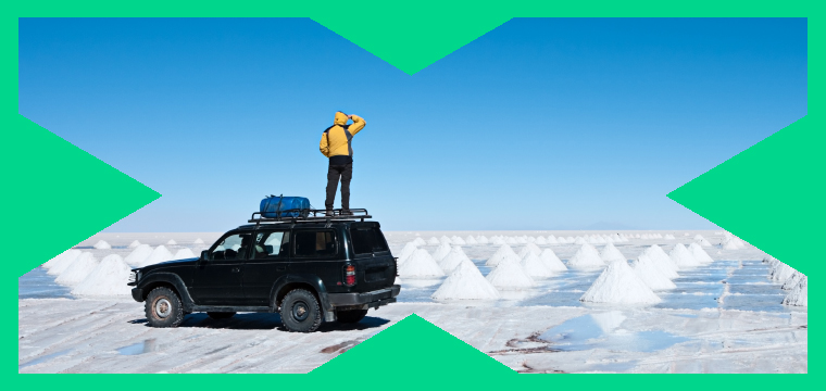 Engineering X brand showing a man standing on top of a 4x4 vehicle, looking across an icy landscape