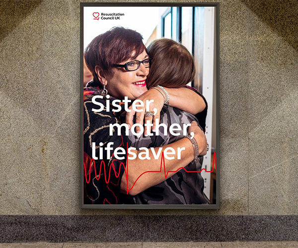 "A poster showing two women hugging, with the text ""Sister Mother Lifesaver"""