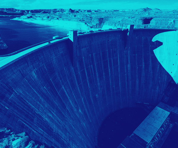 A duotone photo of a large dam in shades of indigo and teal – Royal Academy of Engineering